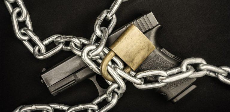 Chained up handgun