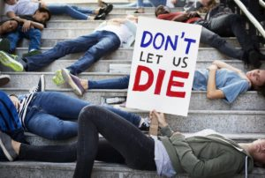 Group of students protest lying down on the staircase