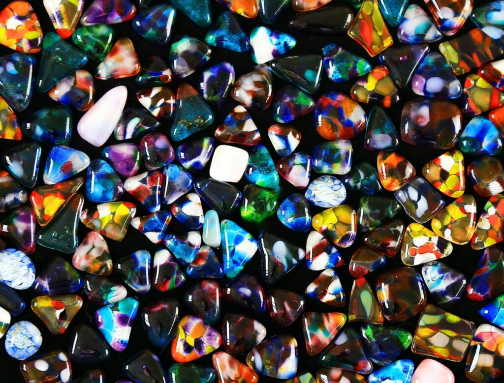 blue green and red heart shaped stone
