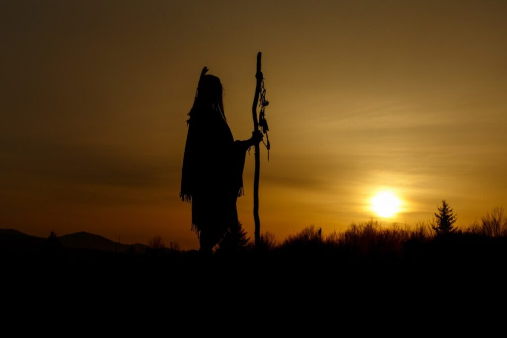 silhouette of native american shaman with pikestaff